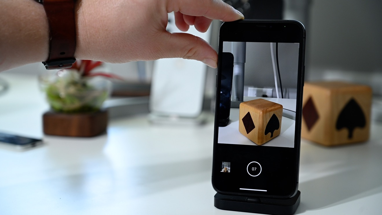 Capture photos continuously with the volume up button